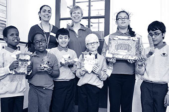 Members of the Invisible Flash team with children from the Joseph Clarke School, showing off their artwork.
